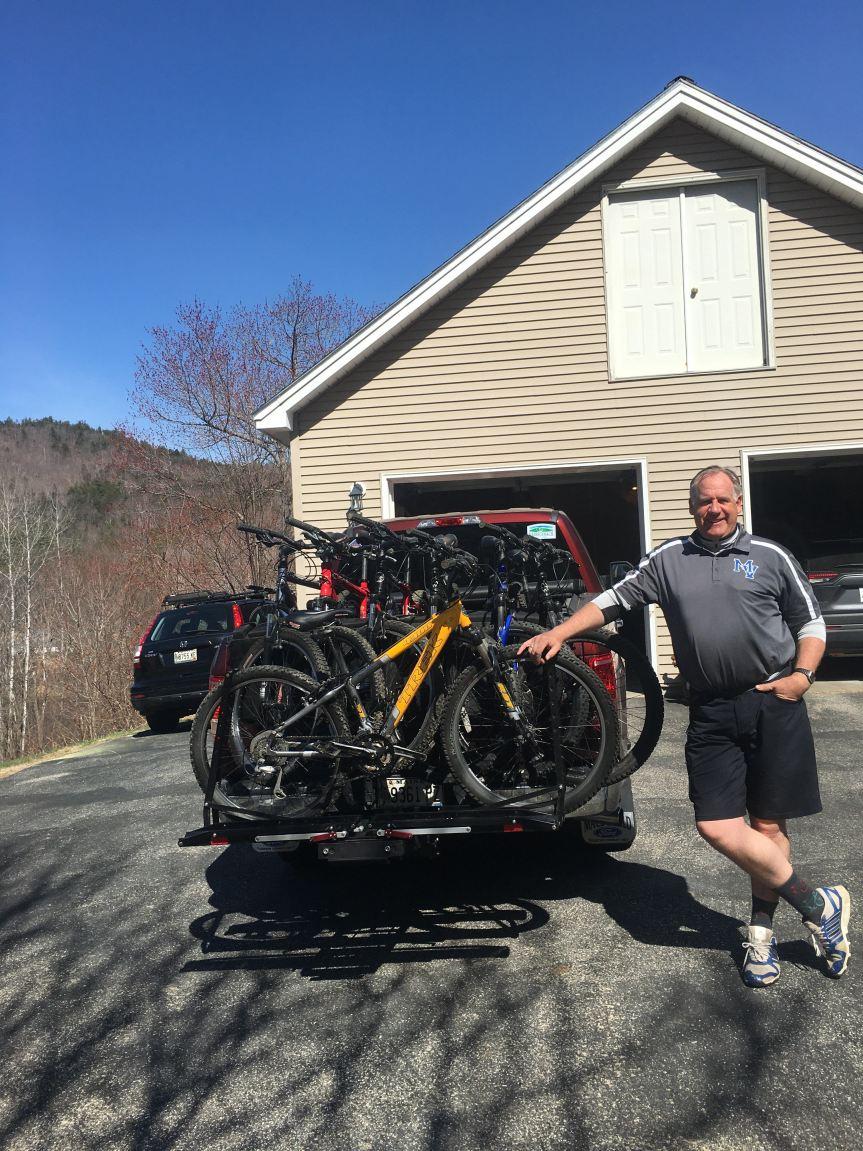 Todd Papianou standing next to bikes