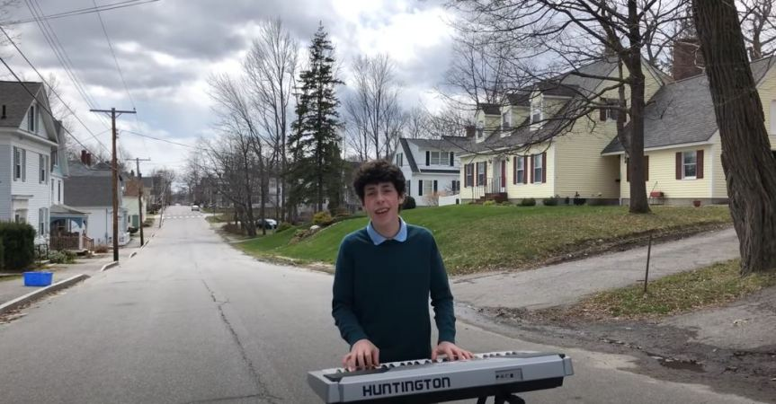 Isaac Ensel playing the keyboard in the street