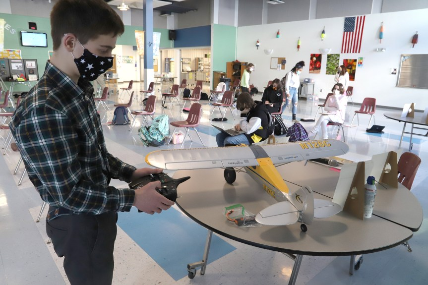 Sawyer Wright: Sawyer Wright demonstrates his model airplane before his presentation on the aerodynamics of flight.