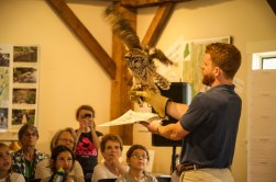 """Matt Weeks, a presenter with Chewonki delighted visitors with a program on """"Owls of Maine""""."""