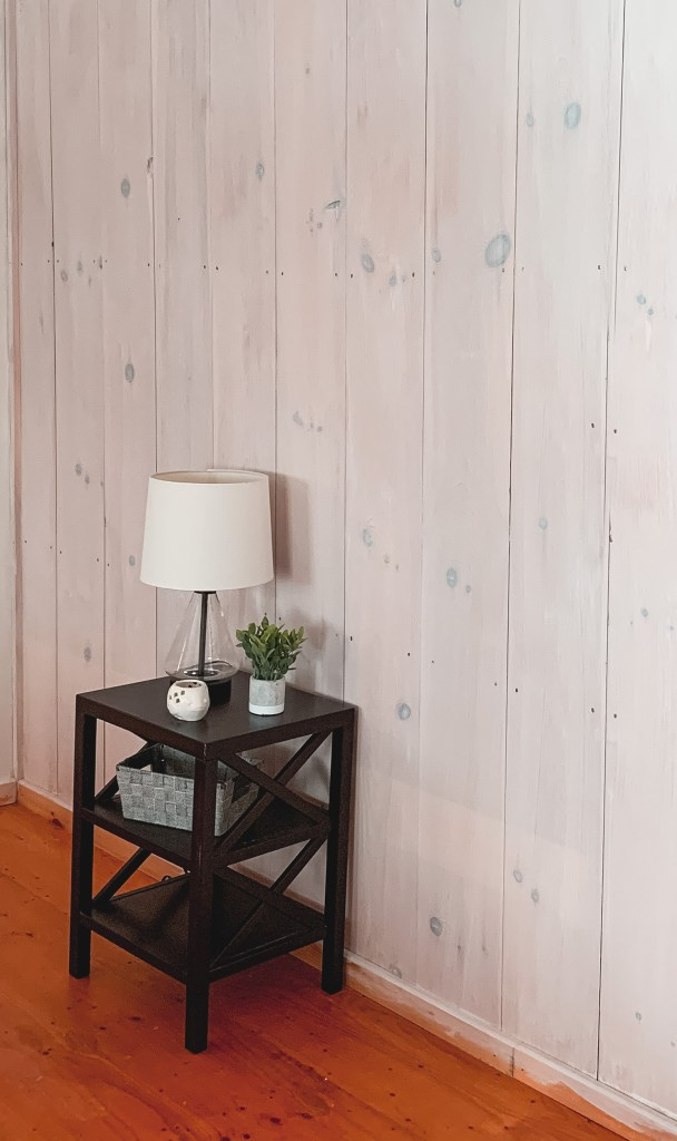White washed plank wood walls with stand
