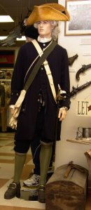Lt. Col. in the District of Maine militia from 1776. One of only two reproduction uniforms in the museum. The re-enactors uniform is accurate down to the buttons. The weapons are authentic.
