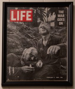 This graphic Life Magazine cover shows real combat during the Vietnam War.