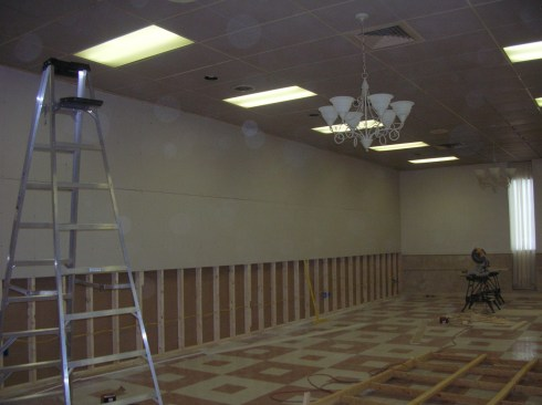 Installing the wall separating the ballroom from the museum.