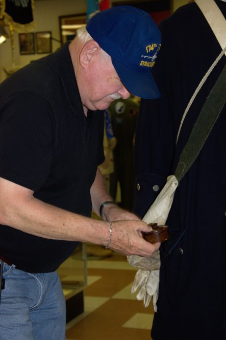 Even the contents of the pockets are authentic. Here the curator is retrieving the contents of the Revolutionary Way officer's pocket.