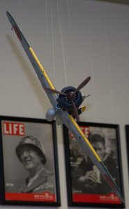 Head on shot of a Japanese Army Zero being chased by an American P-38.