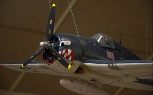 """Close up of the Tiger's mouth on the F6F """"Hellcat"""" of VF- 27 flying off the USS Princeton."""