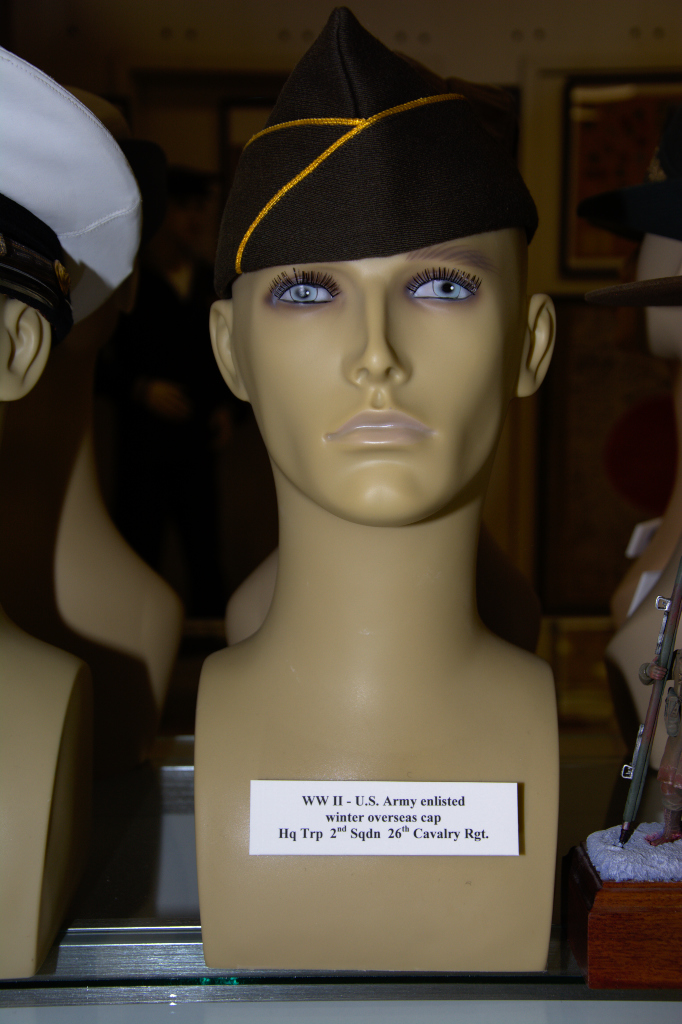 World War II US Army enlisted winter overseas cap worn by HQ Trp 2nd Squadron 26th Cavalry Regt.