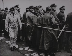 Smiling German prisoners aboard a U.S. Coast Guard ship at Normandy.