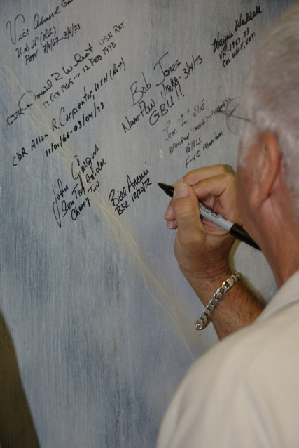 Capt Arcuri Signs the POW Wall