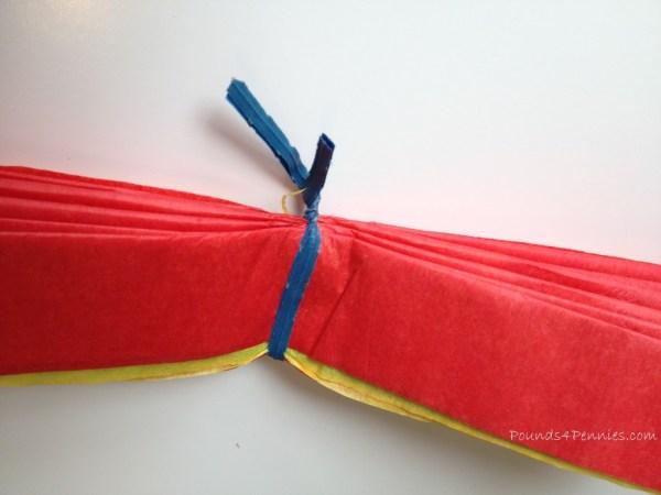 Twist tie for tissue ball turkey craft
