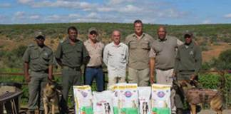 Dog handler - Vusumzi Nxamleko, Section Ranger – Anban Padayachee, Quemic Director – Gerrit Lamprecht, Ballistic Body Armour International Sales Manager – Henry Ainslie, Quemic Regional Ranger – Nikki Haynes, Park Manager – Mzwandile Mjadu and Environmental Monitor - Raghoo Saterdag, with Addo's two dogs, Bullet and Banshee.
