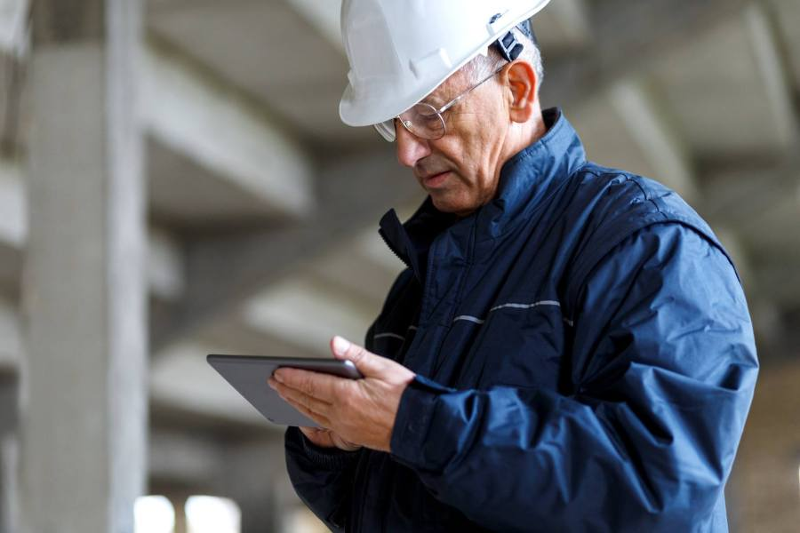 Maintenance Director using EAM Mobility at manufacturing facility