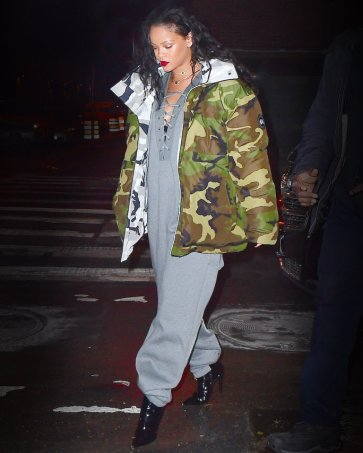 Rihanna was spotted dining at Tao in NYC on Monday night. The singer wore a sexy laced up Jumpsuit from her Fenty x Puma Collection, with a camo winter jacket as she headed inside. She waved to a bystander with a happy smile . She needed assistance from her burly bodyguard to avoid slipping on an icy patch with her Heeled boots on. Later she headed to the club to end her night with a bang. Pictured: Rihanna Ref: SPL1419842 100117 Picture by: 247PAPS.TV / Splash News Splash News and Pictures Los Angeles: 310-821-2666 New York: 212-619-2666 London: 870-934-2666 photodesk@splashnews.com