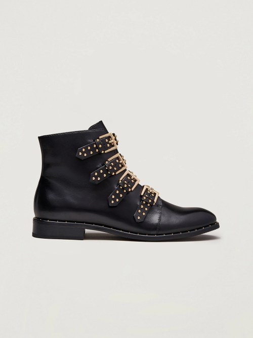Ankle boots with studs and buckles