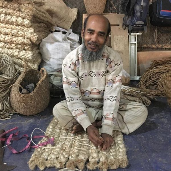 Habib weaving a magical jute carpet
