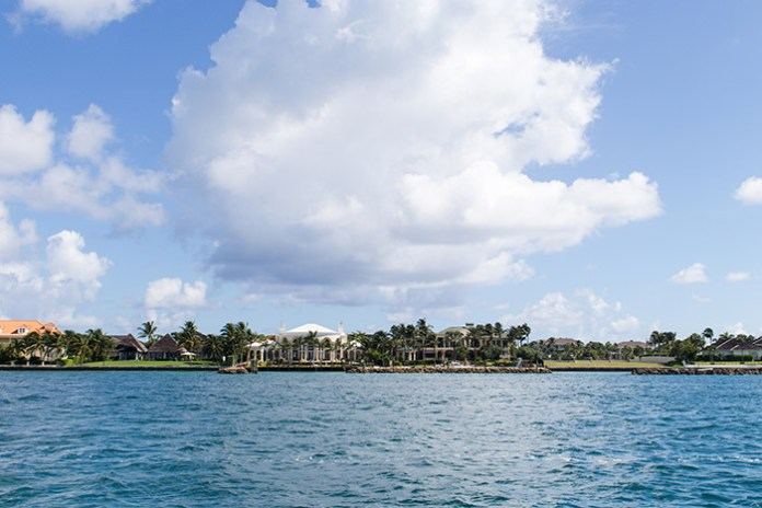 Oprah Winfrey's two houses in the Bahamas seen from a boat.