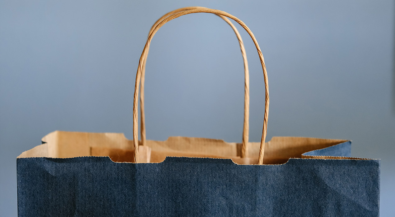 a dark blue paper shoping bag
