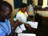 CHWs Jacob and Merciana announcing the cholera outbreak on the MSG radio program