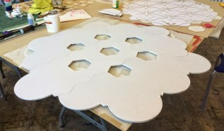 The frame was cut in wood, assembled and primed.