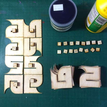 Priming and sanding the laser-cut pieces
