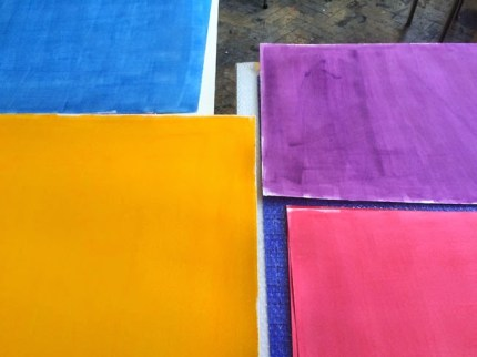 Sheets of watercolour paper are painted yellow on one side, and pink, purple or blue on the other. Although the medium is acrylic, it was deliberately watered down to have an uneven, watercolour-like texture.