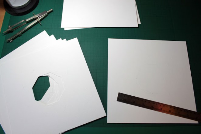 Drawing and cutting the 8 layers in 400gsm paper.