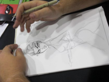 Josh Howard sketches away at the booth.
