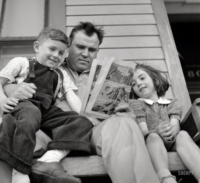"March 1943. Montgomery, Alabama. ""Marvin Johnson, truck driver, reading the 'funnies' to his children."" Happy Father's Day from Shorpy! Photo by John Vachon for the Office of War Information."