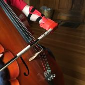 Kevin enjoys his latest cello bow holder so much that, according to his mother, she's not allowed to touch or adjust it in case it gets messed up.