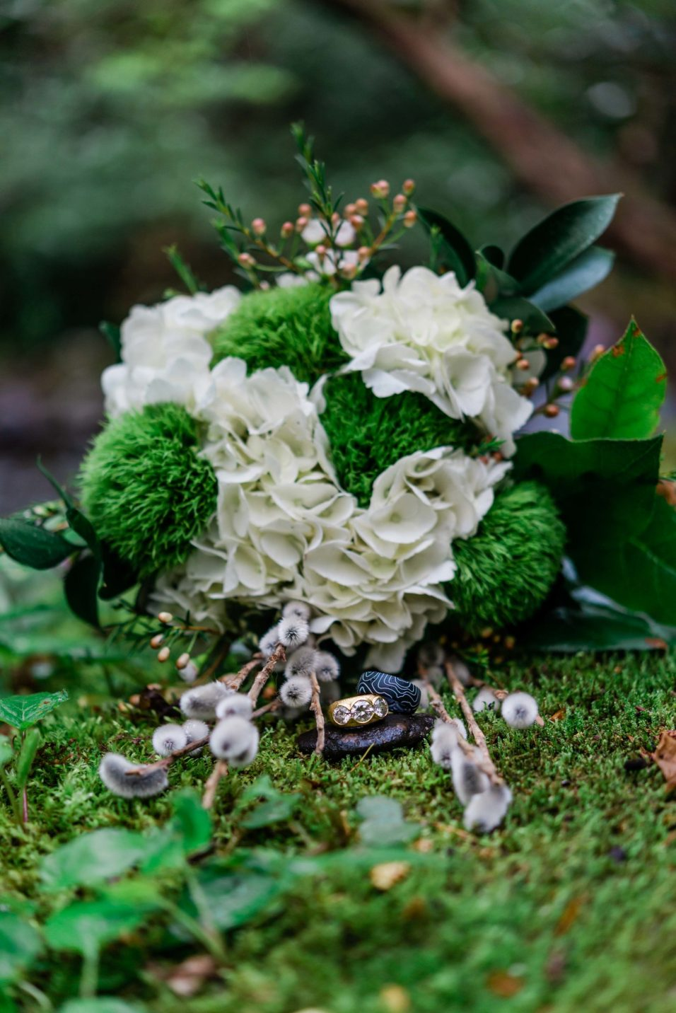 Moss details with the rings and the bouqetduring an adventure elopement