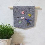 DIY Pin Banner by Make and Fable. A simple no sew felt pennant to display your pins, badges and brooches
