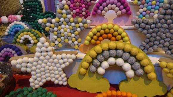 Oh My Pom Pom decorative nursery accessories including pom pom covered rainbows and stars.