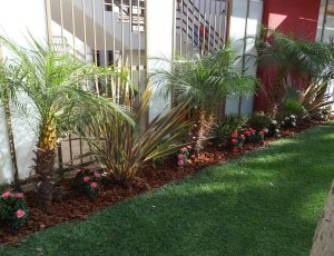 Los Angeles - replaced the existing live flowers in planter beds with UV mixed colorful artificial flowers