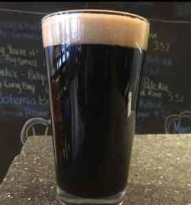 A pint of dry Irish stout home brew sitting on counter