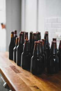 Homebrew beer in bottles on a shelf