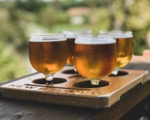 4 homebrewed beer in wine glasses