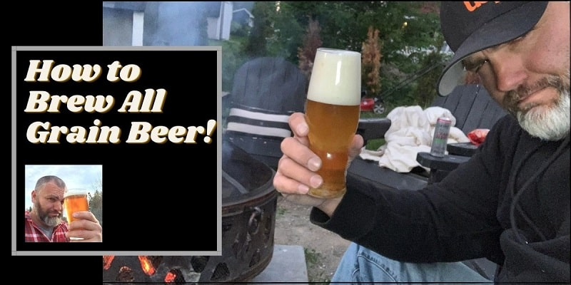 How to Brew All Grain Beer with a man sitting by a bon fire and beer in his hand.