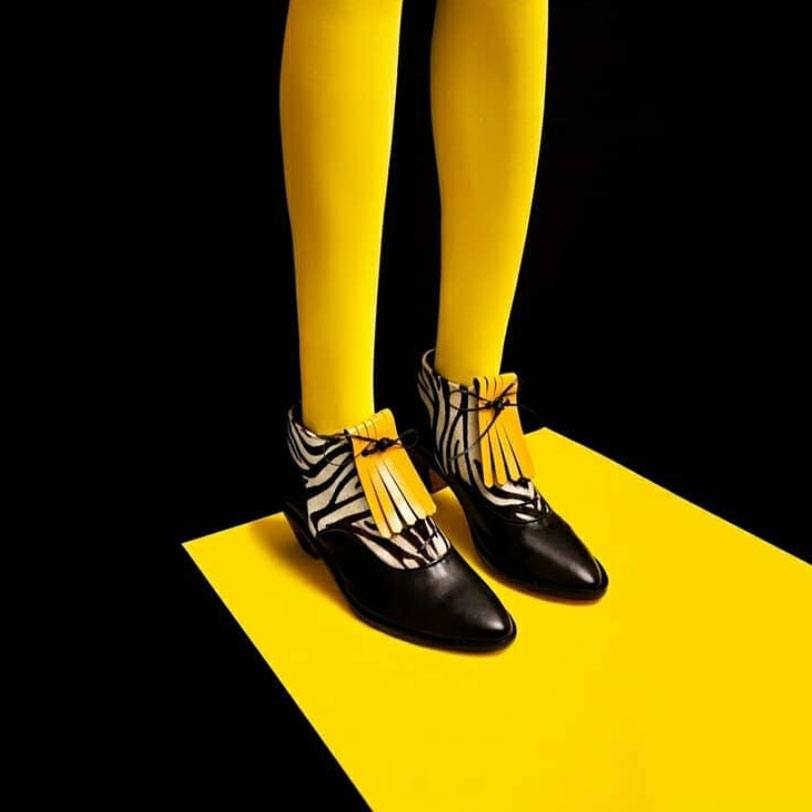 Yellow tights, black shoes, leather shoe accessories by Sovereign Collection