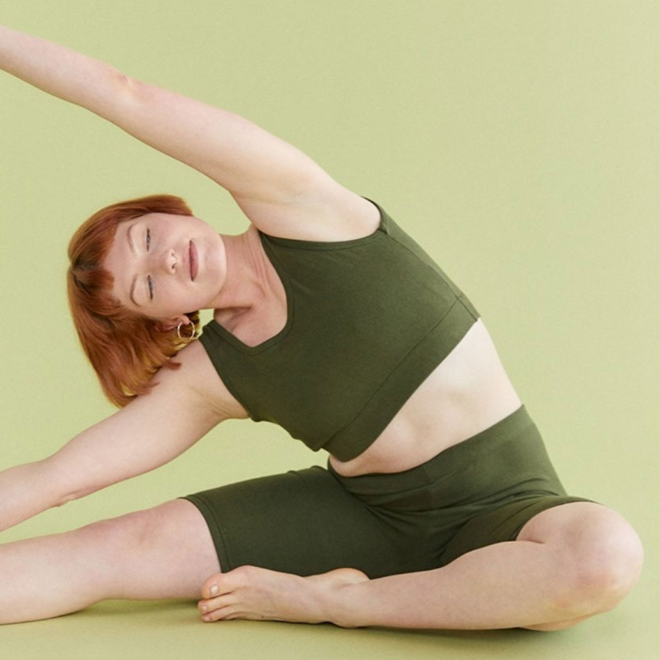 Vege Threads Woman in Yoga Pose with Crop and shorts in green