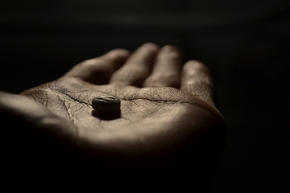 Hand holding placebo pill