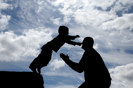 Boy jumping to land safely in fathers arms