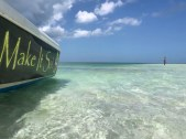 Side view of make it so boat at a sandbar