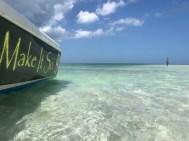 Side view of make it so boat at a sandbar