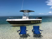 Key west sandbar with chairs and boat pic