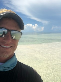 Captain Howie selfie with sandbar backdrop