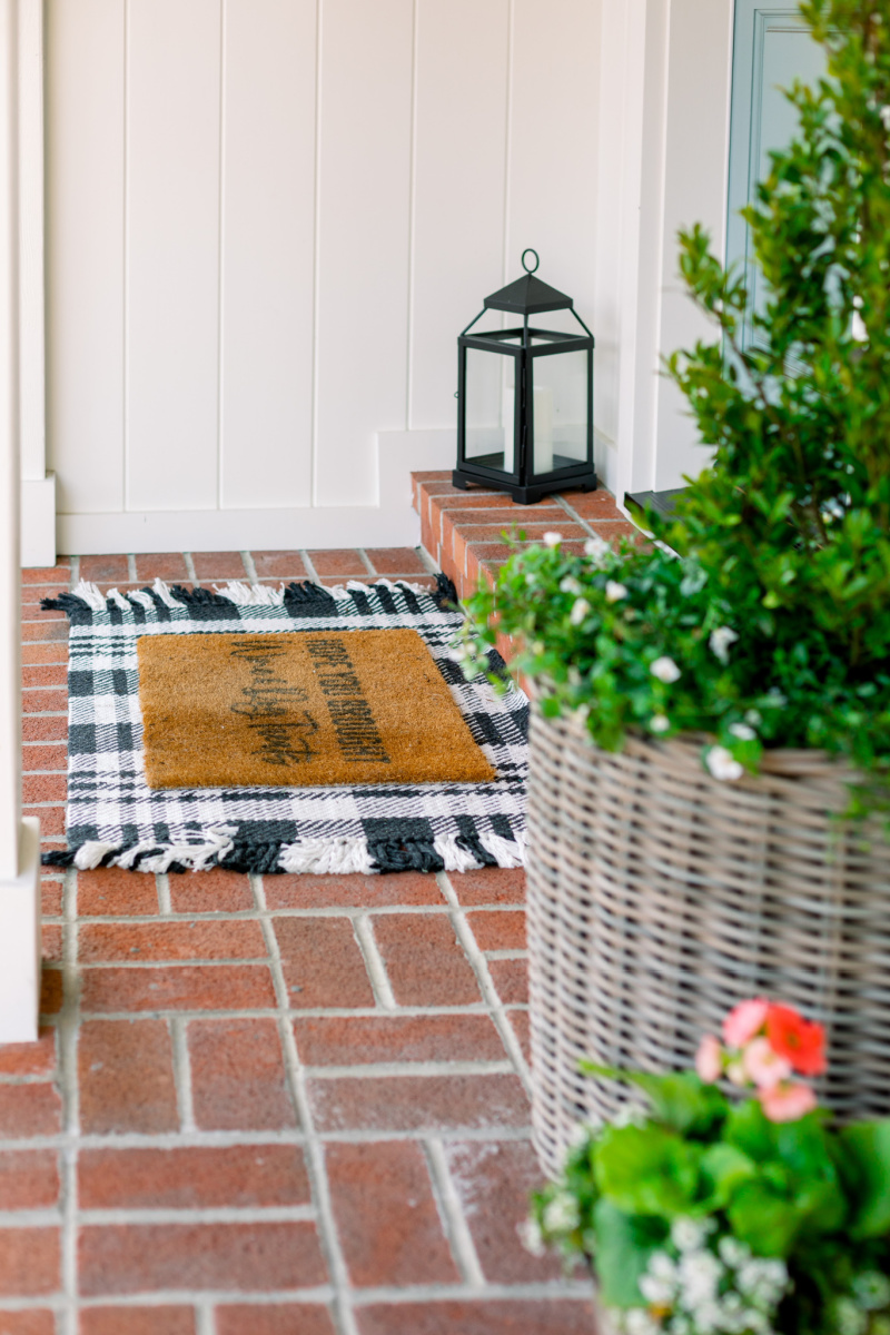 Front porch with layered doormat