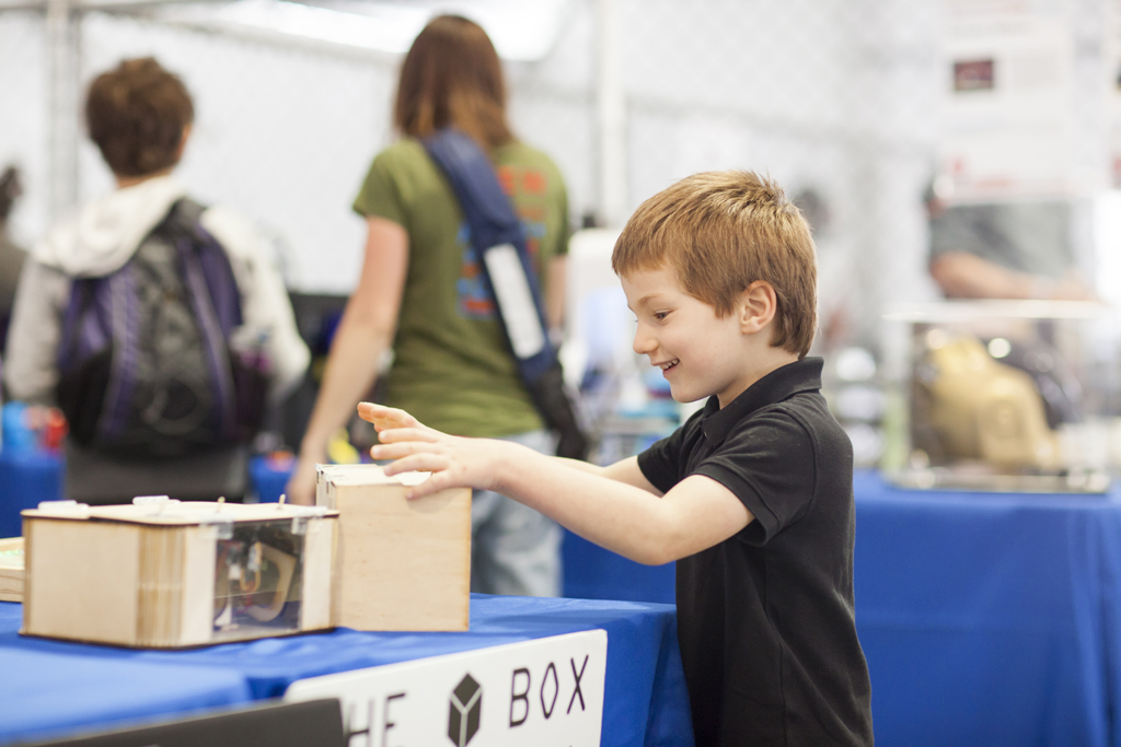 SAN MATEO, CA May 20 2016 - A young boy plays with The Box during the 11th Annual Maker Faire Bay Area at the San Mateo County Event Center.