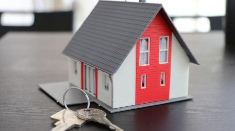mini house and a key