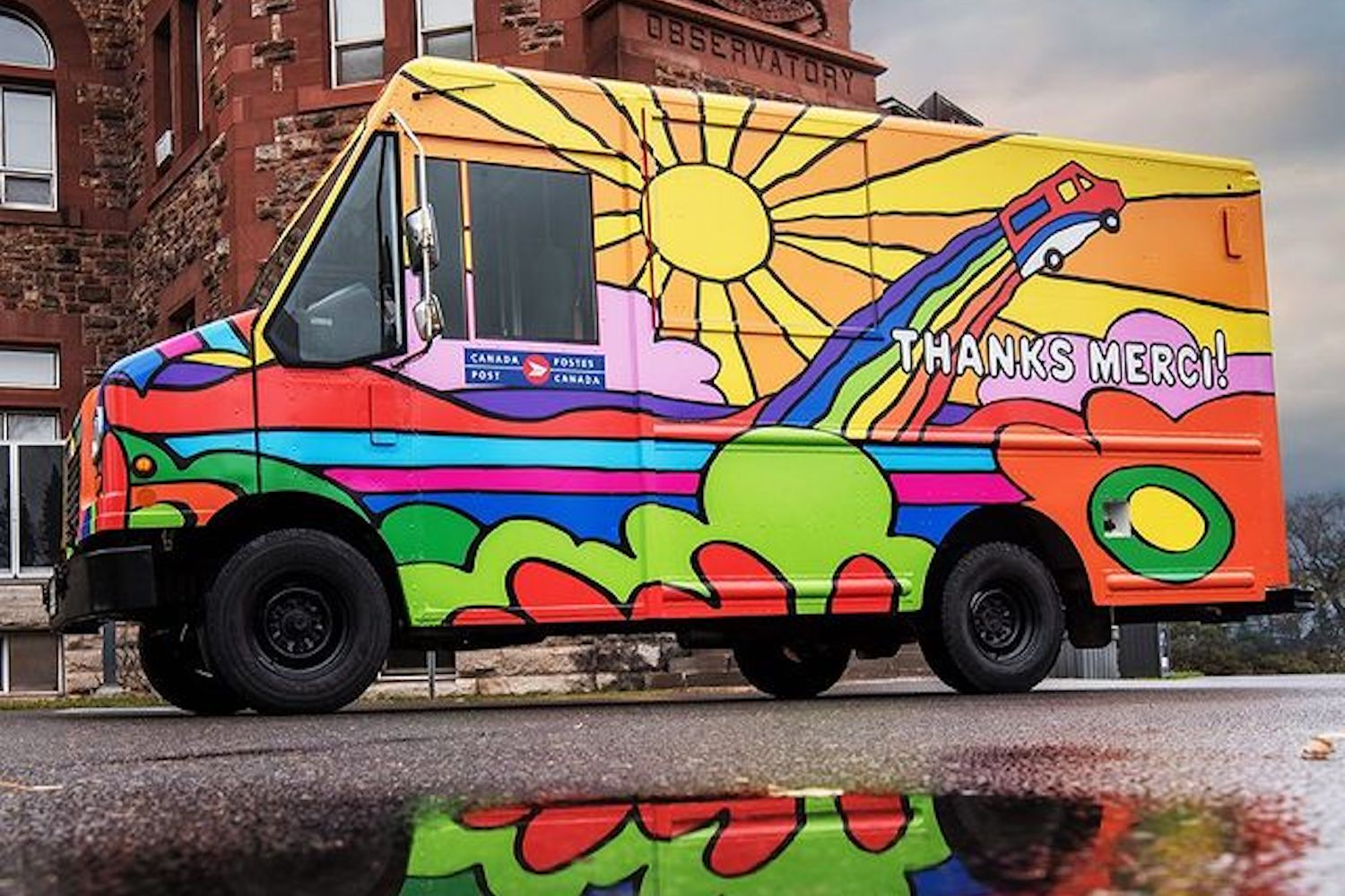 Colourfully painted Canada Post truck.